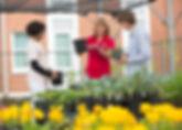 FSDB Garden Center teacher working with two students.