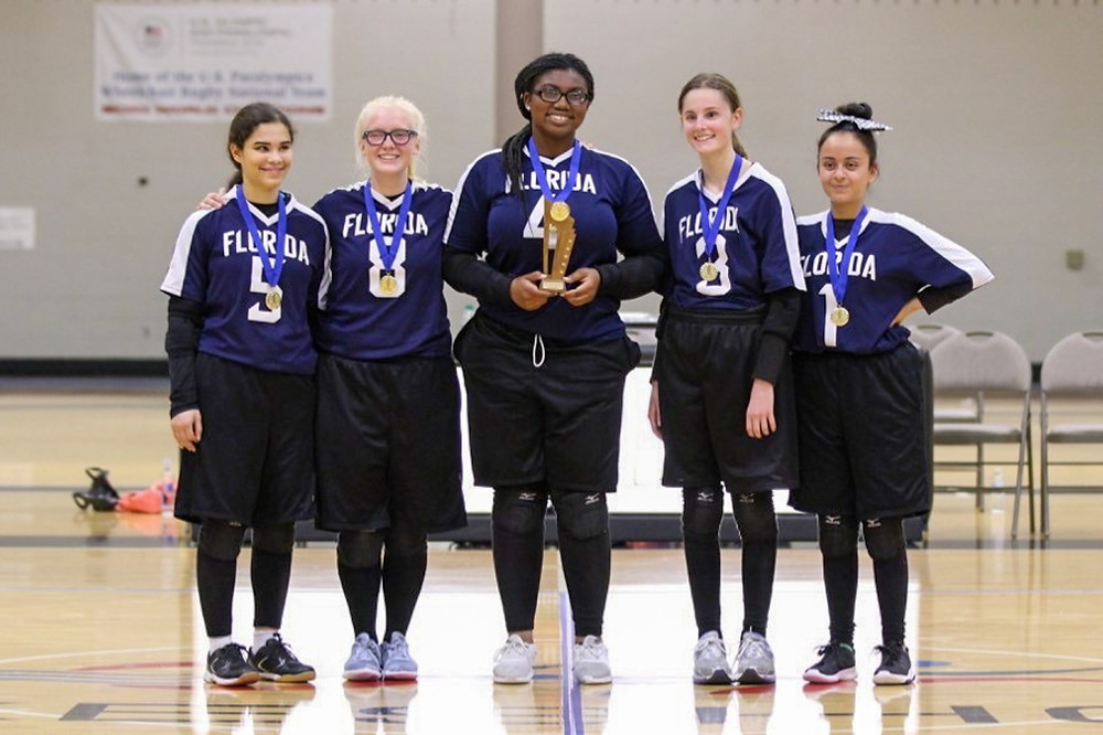 FSDB Girls Goalball Team A holding up 1st place trophies.