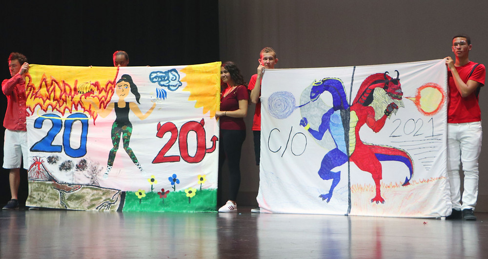 FSDB Deaf High School students holding up hand drawn banners for Homecoming 2019.
