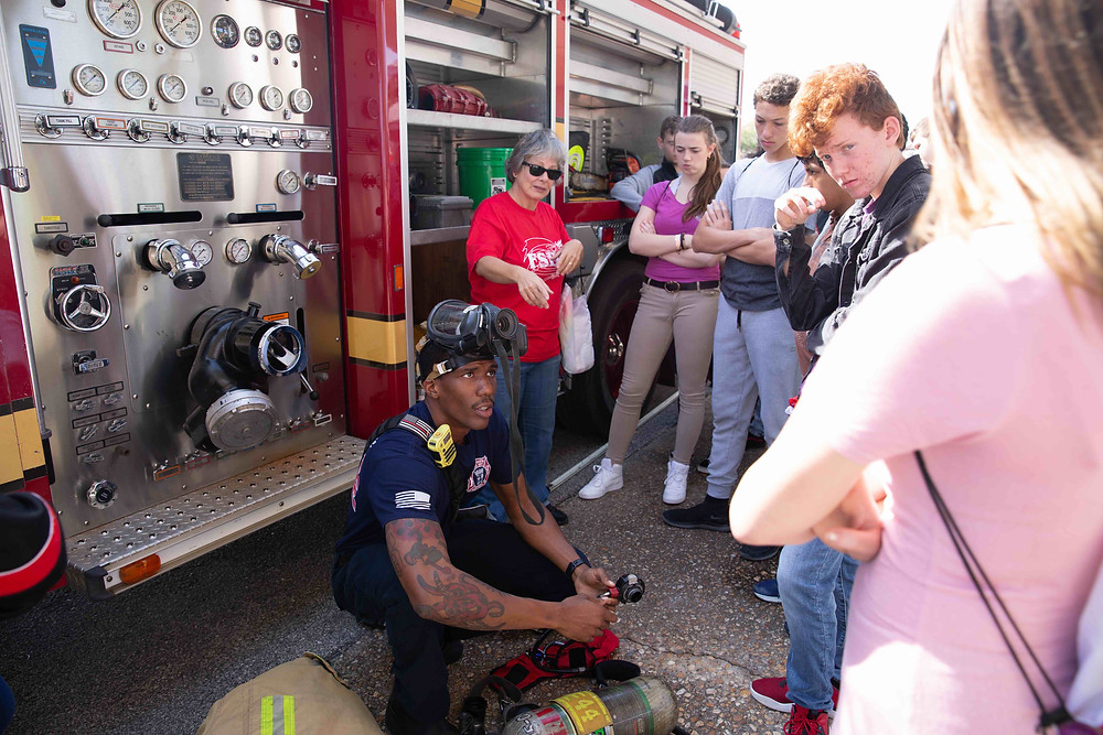 Fireman showing students his gear at the FSDB Safety Summit.