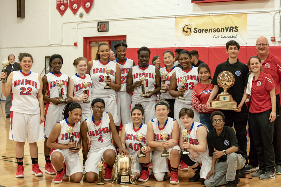 FSDB Girls Basketball team holding 1st place trophies from the Mason-Dixon tournament.