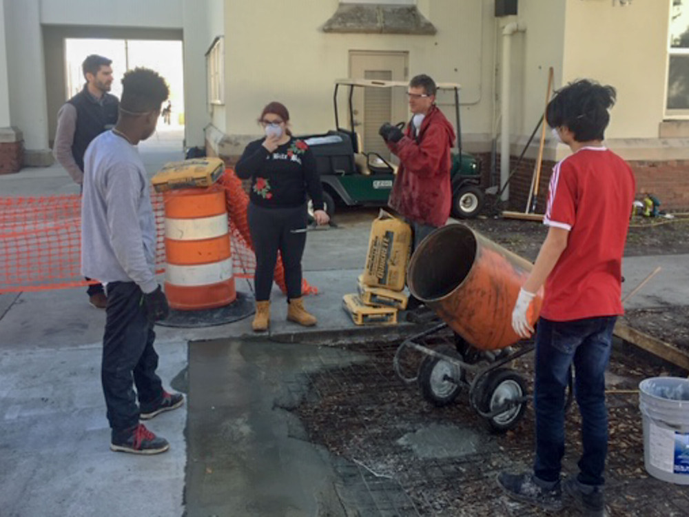 Students about to pour cement.