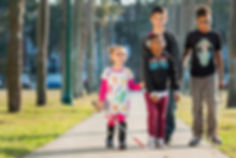 FSDB deaf and blind elementary students walking down palm row.