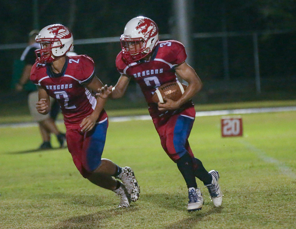 FSDB running back Luis Merced (3) follows quarterback Matthew Guillou (2).