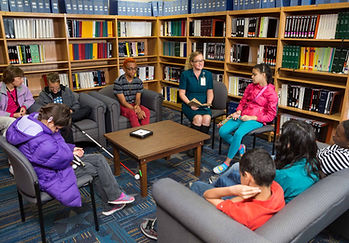 Blind students listening to a story in the blind library.