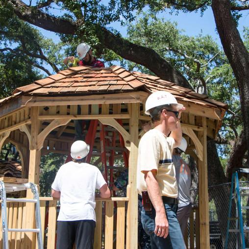 FSDB students prepare the gazebo for the cupola.