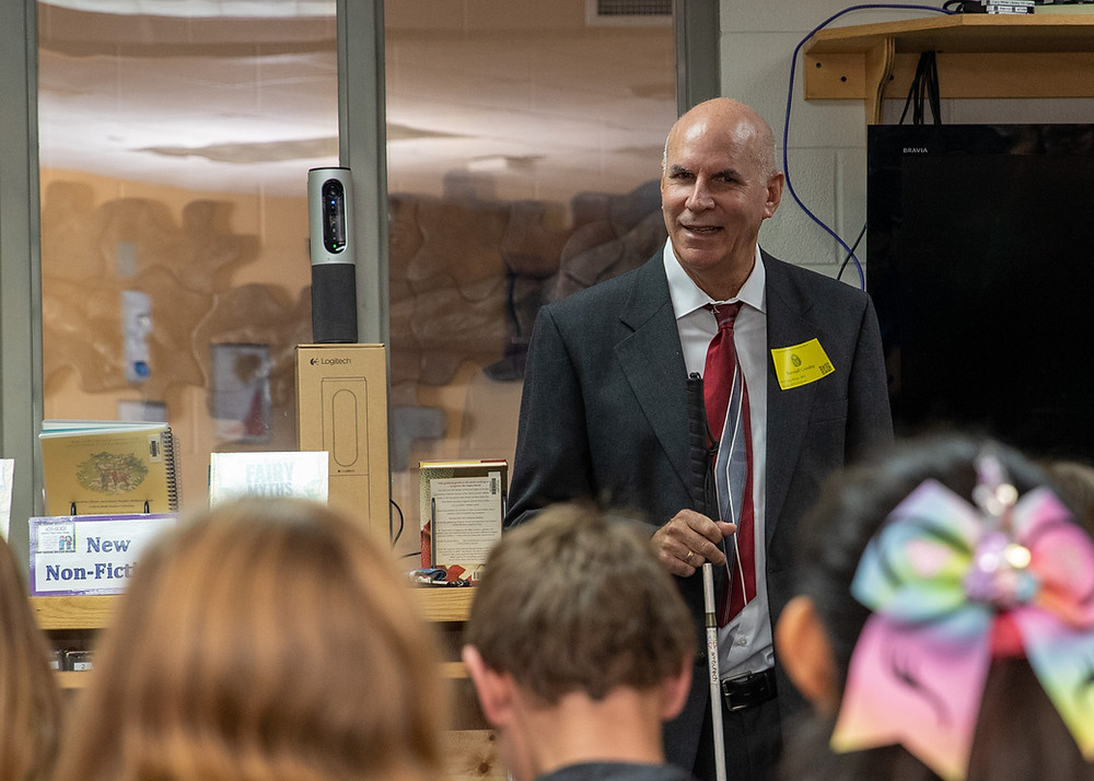 Randall Crosby speaking to blind middle school students.
