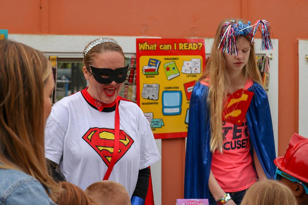FSDB staff wearing Superman shirt and catwoman mask.