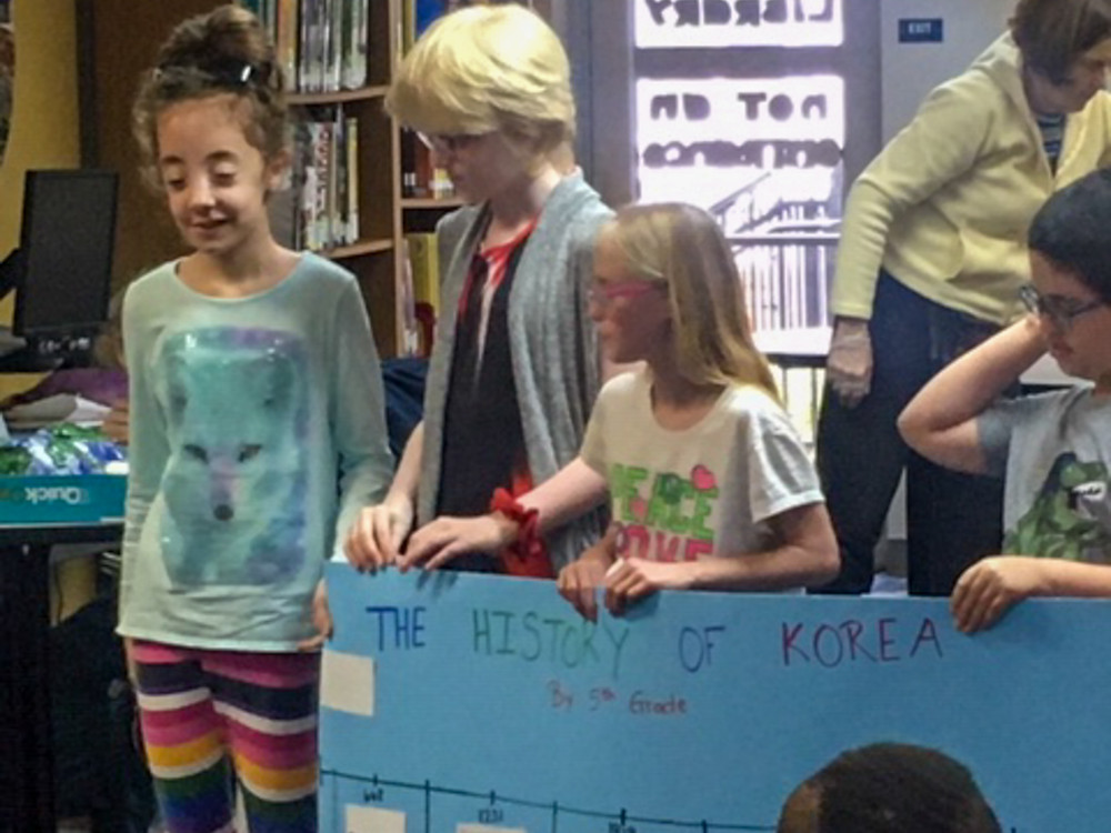 Elementary students presenting about Korea.