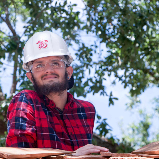 Tyler Ames, FSDB Deaf High School student, stands on top of ladder to help put on cupola.