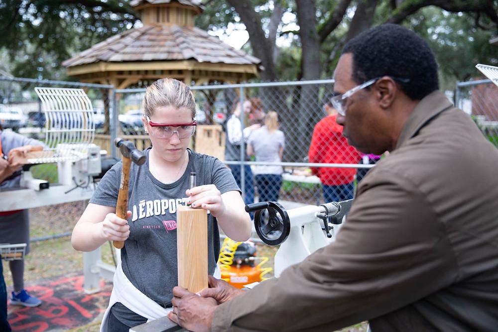Girl hammering nail into wood at the FSDB CTE Showcase.