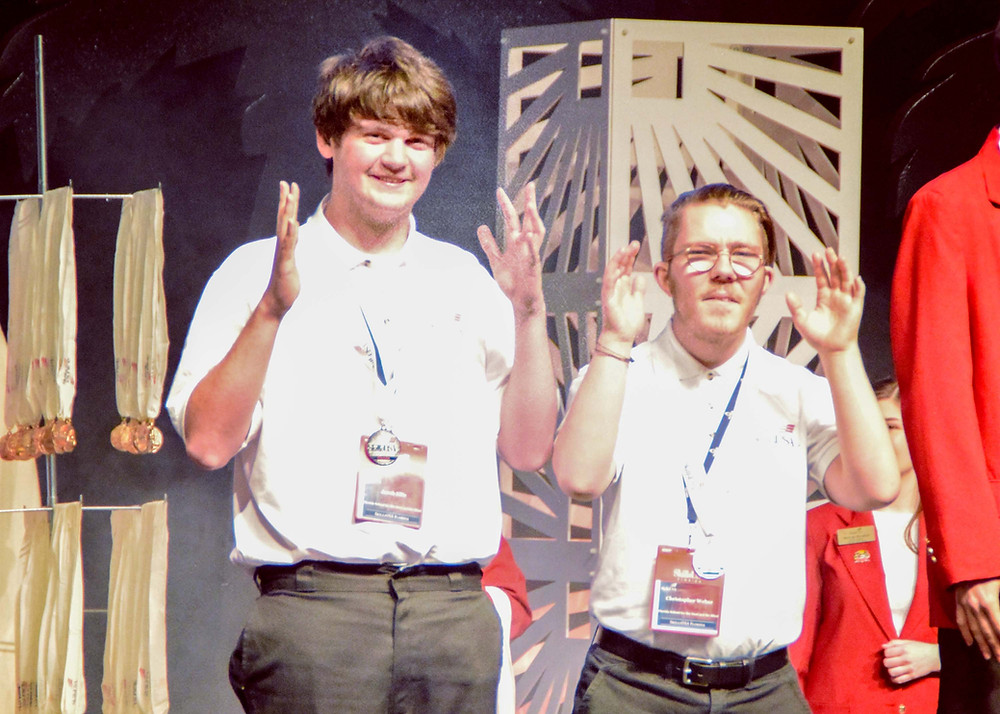 FSDB students Jacob and Chris receiving their silver medal at the State SkillsUSA Competition.