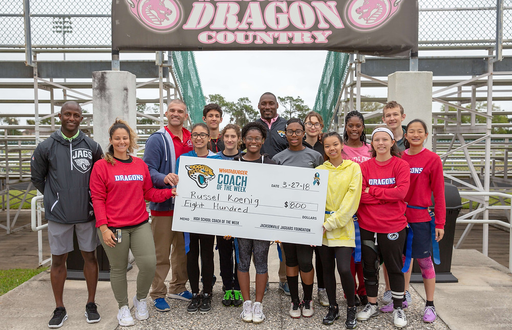 FSDB Flag Football team receiving $800 check from the Jacksonville Jaguars Foundation.