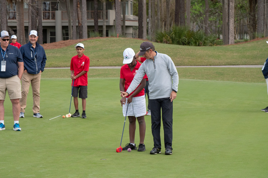 FSDB student being instructed how to putt.
