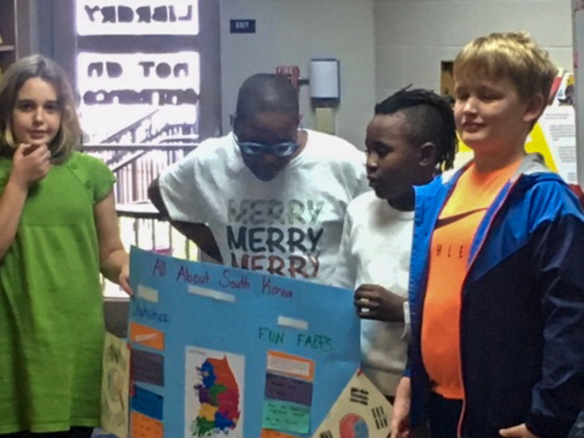 Elementary students presenting about South Korea.