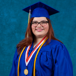 Derlim Cotté-Alvarado in her blue graduation cap and gown.