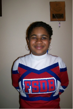 Jasmyn Polite in her cheerleading uniform.