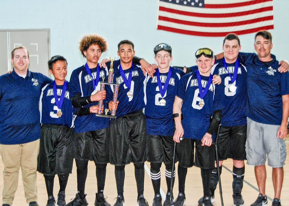 FSDB Boys Goalball team holding National Championship trophy.