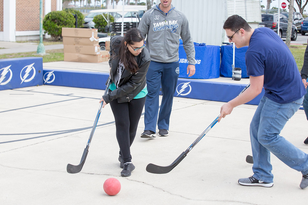 Natalie playing hockey against a classmate.
