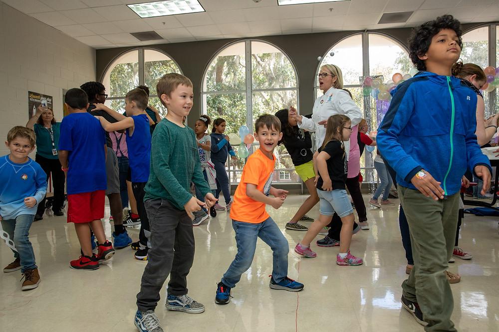 Deaf elementary students dancing.