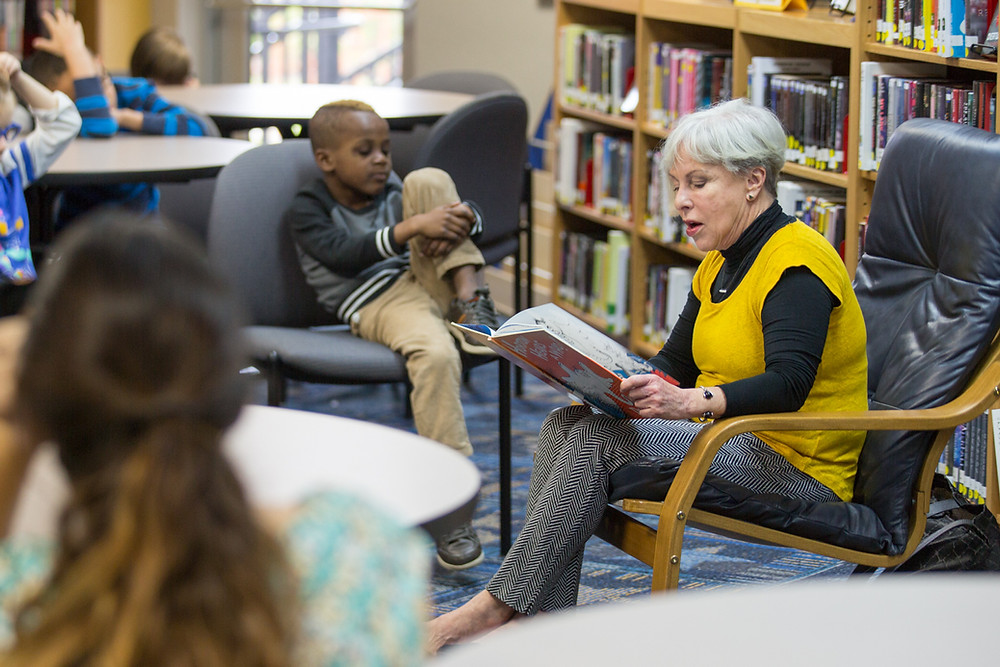 Mayor Shaver reading to Blind Elementary students in Cary White Library.