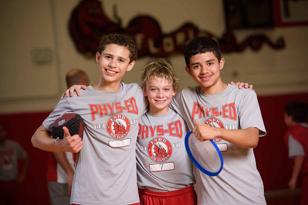 Three boys in their PE uniform.