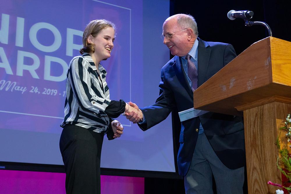 FSDB senior Reahna Robinson receiving an award from FSDB Board Member Dr. Tom Zavelson.