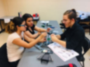 Students working together in Robotics club.