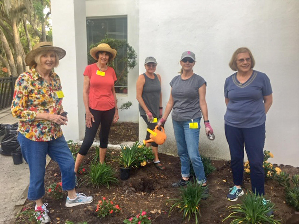 Members of the Las Adelfas Garden Circle planting flowers.