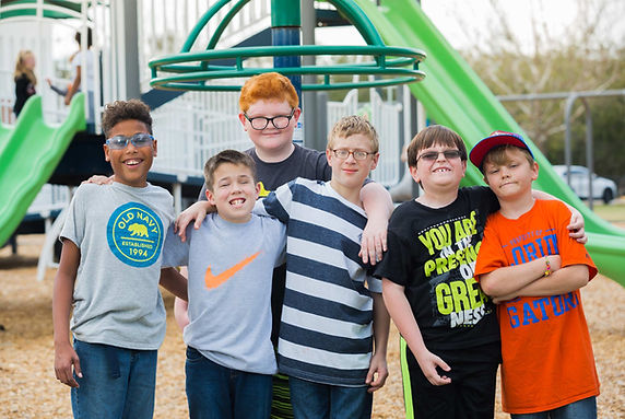 Six FSDB blind boys pose for picture on playground.
