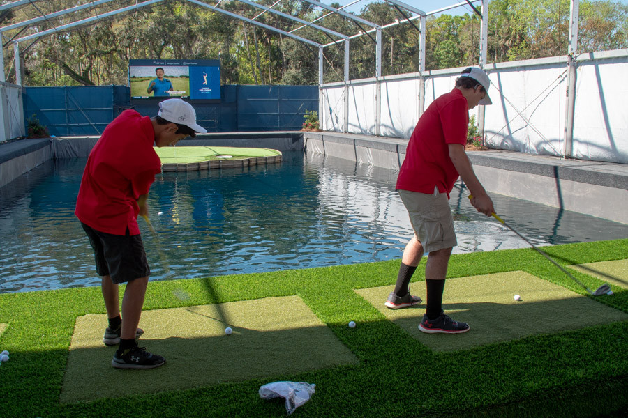 Two FSDB students hitting golf balls.