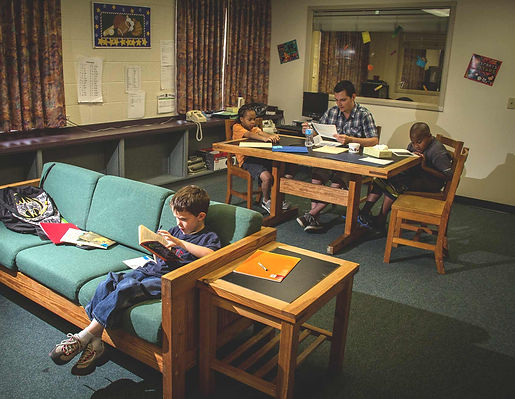 FSDB blind elementary students complteting homework in dorm.