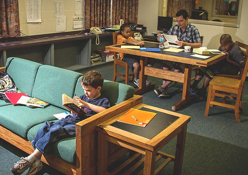 FSDB blind elementary students doing homework in dorm.