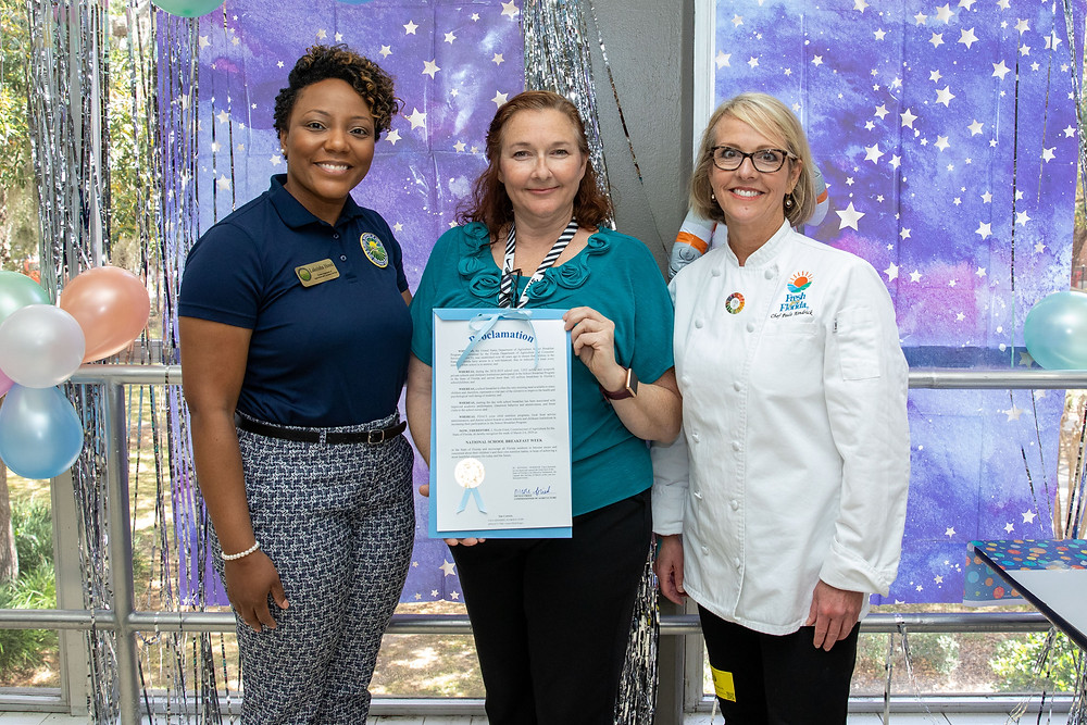 Lakeisha Hood and Chef Paula present Jessica Littlefield with proclamation.