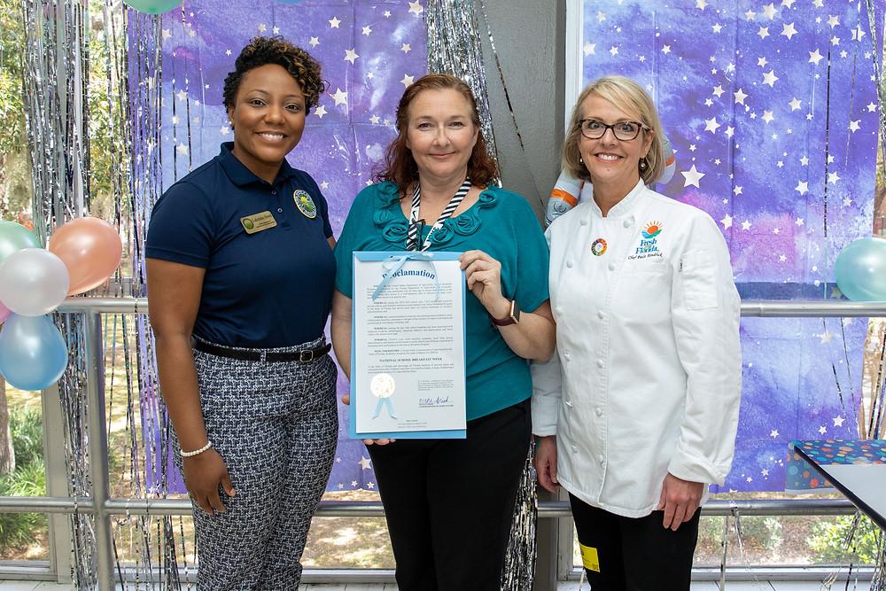 Lakeisha Hood and Chef Paula present Jessica Littlefield with proclamation.