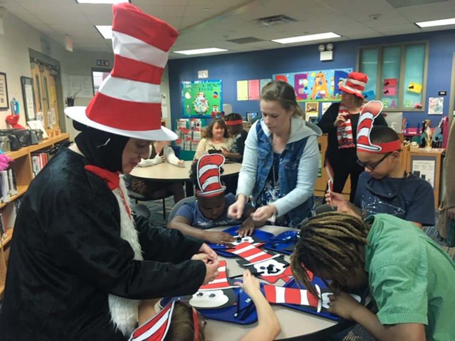 Joy Carriger dressed as Cat in the Hat working with students.