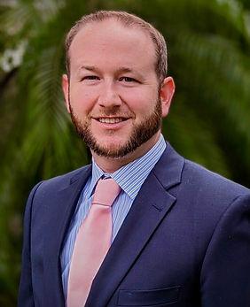 Nick Solomon in a blue blazer and peach necktie