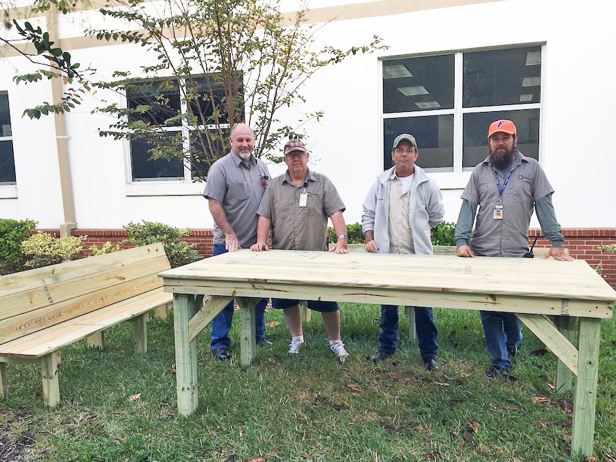 "FSDB Carpentry department staff helped build benches and a table for an outdoor classroom (Left to right: David Cain, Clinton ""Clinny"" Schmermund, Jimmy Setzer, and Justin Escobedo)"