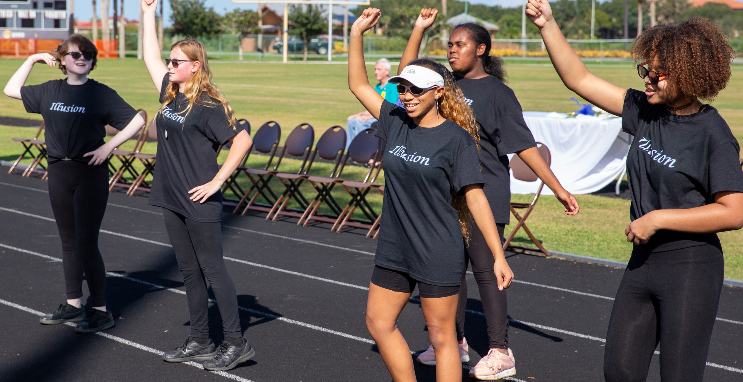 Illusion members dancing on the track.