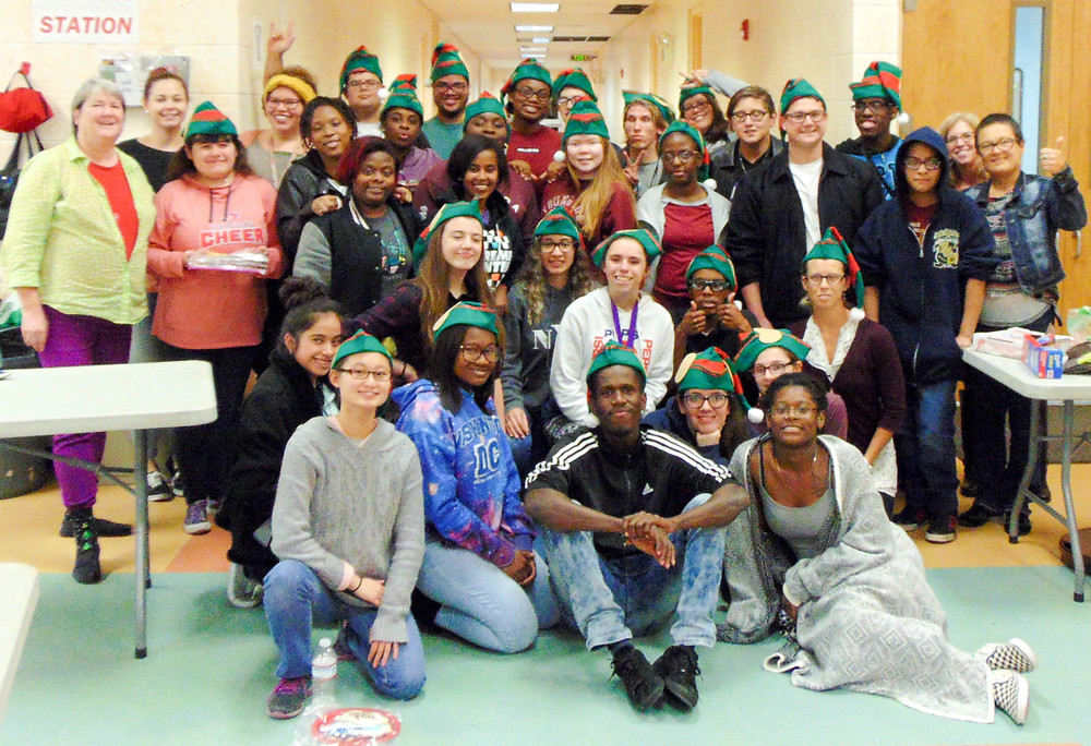 FSDB students pose for photo during gingerbread making activity