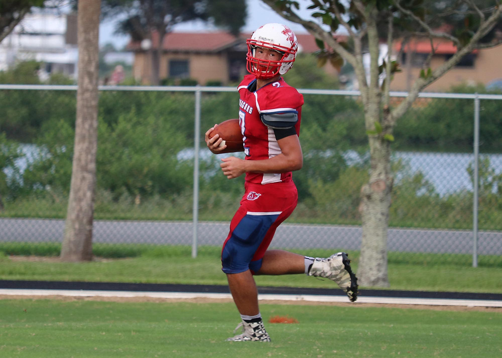 FSDB Quarterback Matthew Guillou runs in for a touchdown.