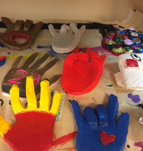 Different handshapes made out of clay and painted in different colors.