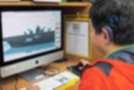 FSDB student using CAD program to draw a 3D ship.
