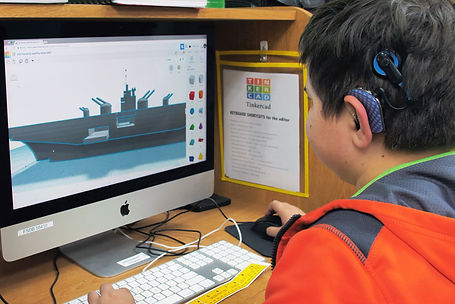 FSDB student using CAD program to draw a 3D ship.