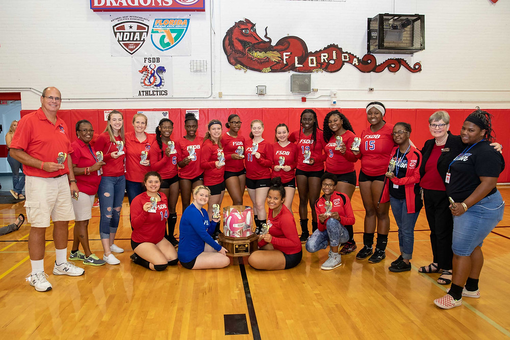 FSDB Volleyball team holding their 1st place Mason-Dixon trophies.