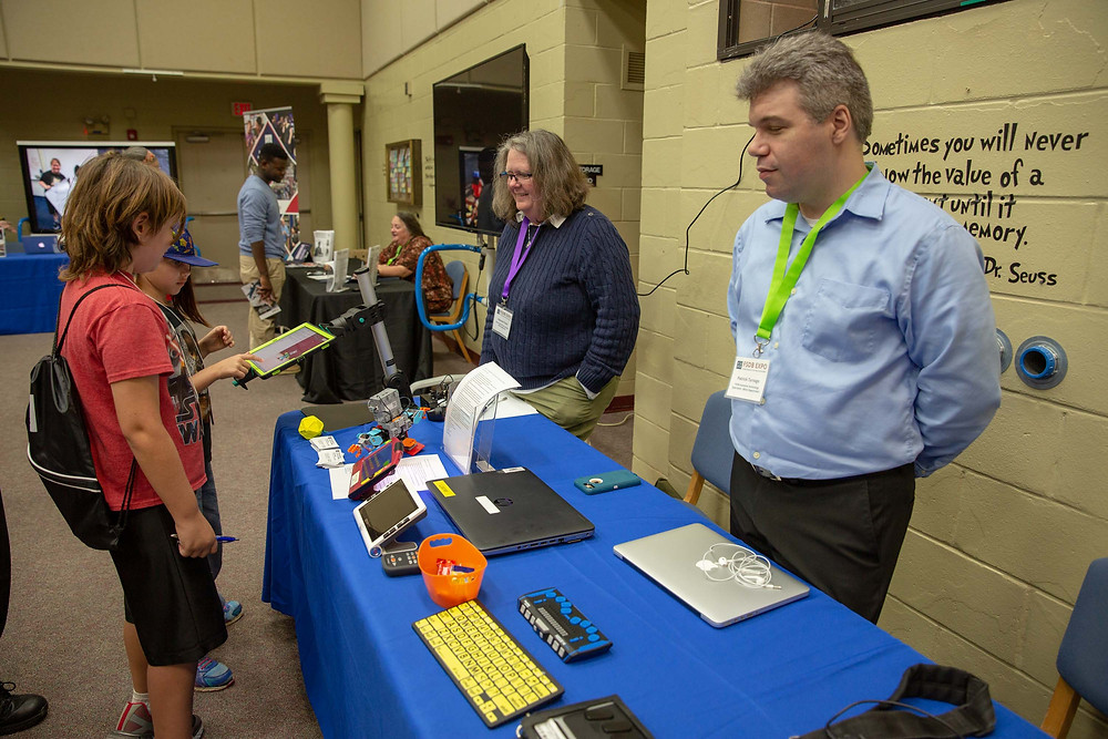 FSDB staff show off assistive technology during the expo.