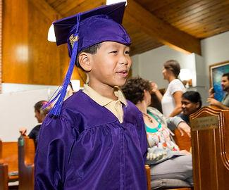 Deaf ELC boy walks during graduation ceremony