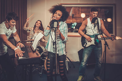 Multiracial music band performing in a r