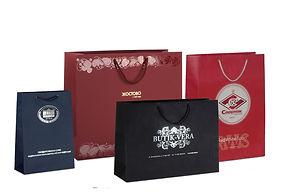 Бумажные пакеты на заказ с логотипом из эфалина и дизайнерской бумаги