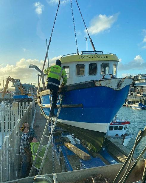Crane lifting boat.jpg